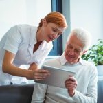 nurse-helping-patient-manage-healthcare-with-digital-technology
